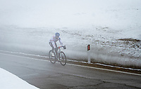 Maglia Azzurra / KOM Leader / Mountains Clasification Leader Geoffrey Bouchard (FRA/AG2R Citroën) coming down the misty Passo Giau<br /> <br /> due to the bad weather conditions the stage was shortened (on the raceday) to 153km and the Passo Giau became this years Cima Coppi (highest point of the Giro).<br /> <br /> 104th Giro d'Italia 2021 (2.UWT)<br /> Stage 16 from Sacile to Cortina d'Ampezzo (shortened from 212km to 153km)<br /> <br /> ©kramon