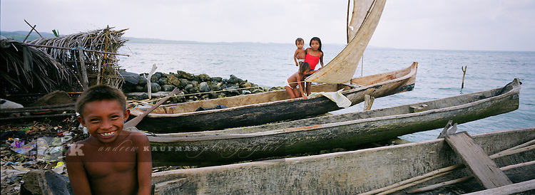 In Panama's Carribean archipelago Kuna Yala there are three hundred and fifty isles. There are said to be 65.000 Kuna Indians. The live across the islands. The islands are autonomous and live according to their own laws not Panama's. The Kuna elders are named Shilah's. ..