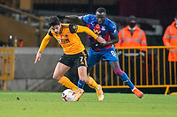 30th October 2020; Molineux Stadium, Wolverhampton, West Midlands, England; English Premier League Football, Wolverhampton Wanderers versus Crystal Palace; Pedro Neto of Wolverhampton Wanderers shields the ball from Cheikhou Kouyaté of Crystal Palace
