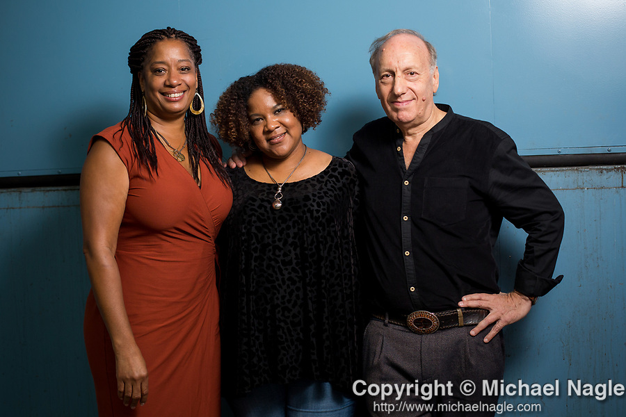 BROOKLYN, NY -- AUGUST 30, 2018:  Lisane Basquiat, left, Jeanine Basquiat, center, sisters of artist Jean-Michel Basquiat, and director David Shulman, right, pose for a portrait after a screening of David Shulman's documentary Basquiat: Rage to Riches at the Brooklyn Museum on August 30, 2018 in Brooklyn.  (PHOTOGRAPH BY MICHAEL NAGLE)