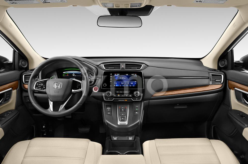 Stock photo of straight dashboard view of 2021 Honda CR-V-Hybrid EX 5 Door SUV Dashboard