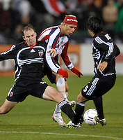 DC United defender Bryan Namoff (26) fights to gain control of the ball while defended by CD Guadalajara Adolfo Bautista (1) and helped by DC United defender Facundo Erpen (5) in the first leg of the 2007 CONCACAF Champions' Cup Semifinal match between DC United and CD Chivas from Guadalajara, DC United tied Chivas 1-1 on March 15, 2007 at RFK Stadium in Washington DC.