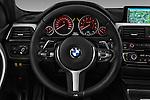 Car pictures of steering wheel view of a 2016 BMW 3 Series M Sport 5 Door Wagon Steering Wheel