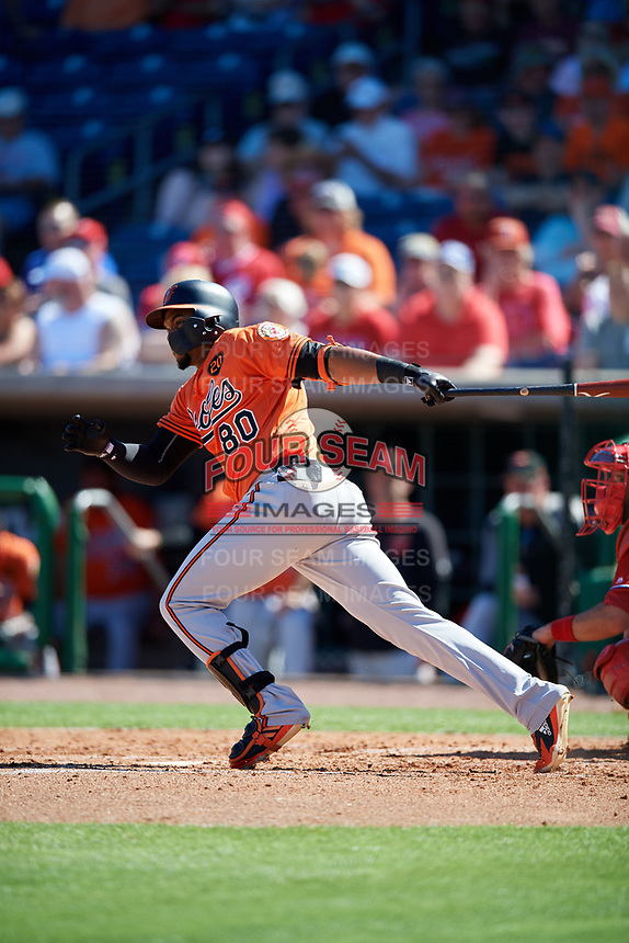 Baltimore Orioles right fielder Yusniel Diaz (80) follows through on a swing during a Grapefruit League Spring Training game against the Philadelphia Phillies on February 28, 2019 at Spectrum Field in Clearwater, Florida.  Orioles tied the Phillies 5-5.  (Mike Janes/Four Seam Images)