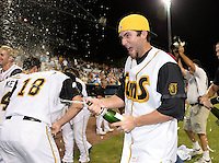 Jacksonville Suns pitcher Trevor Williams (9) celebrates on the field after clinching the Southern League Championship Series against the Chattanooga Lookouts on September 12, 2014 at Bragan Field in Jacksonville, Florida.  Jacksonville defeated Chattanooga 6-1 to sweep three games to none.  (Mike Janes/Four Seam Images)