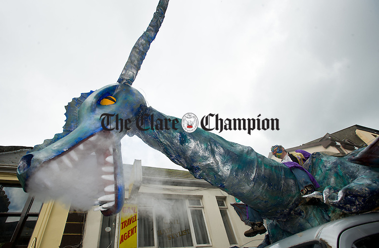 A large dragon heads down O Connell street during the St Patrick's Day parade at Ennis. Photograph by John Kelly.
