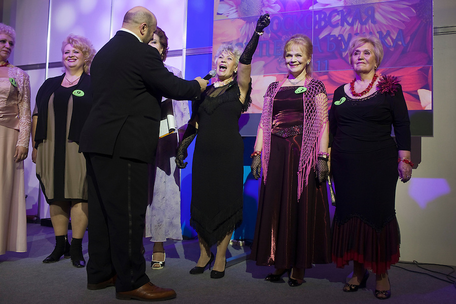 Moscow, Russia, 02/11/2011..Competitors answer questions onstage at the first Moscow Super-Babushka contest. A total of 105 women aged over 50 entered to compete for various titles, including most stylish, modern, elegant, business-minded, creative, artistic, and cheerful granny. The overall winning title of Super-Babushka was taken by 73 year old Ludmilla Trafinovna in the event organised by the Moscow City Government Social Welfare Department.