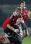 Hooker Duncan Casey of Munster Rugby is tackled by Second row Rynard Landman of Newport Gwent Dragons.<br /> <br /> Guiness Pro 12<br /> Newport Gwent Dragons v Munster Rugby<br /> Rodney Parade<br /> 21.11.14<br /> ©Steve Pope-SPORTINGWALES