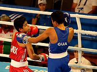 BARRANQUILLA - COLOMBIA, 25-07-2018: CAPILLA FLORES Miguel A. (Mexico) vs VALENZUELA B. Eddie (Guatemala) durante su participación en boxeo masculino categoría minimosca como parte de los Juegos Centroamericanos y del Caribe Barranquilla 2018. /  CAPILLA FLORES Miguel A. (Mexico) vs VALENZUELA B. Eddie (Guatremala) during their participation in the boxing men's light fly category of the Central American and Caribbean Sports Games Barranquilla 2018. Photo: VizzorImage  / Cont