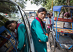 19 September  2013, New Delhi, INDIA:  Geeta Kumari, 21 driver of a ' women only ' taxi , next to a line of rickshaw's operated by men. The service is run by Sakha Consulting Wings in New Delhi that has begun training more young women drivers to meet increasing demand. The recent spate of violent attacks against women in New Delhi has prompted segregation of the sexes on transport to be highlighted as a neccesity. Many local women feel much safer travelling in taxi's driven by women and travelling in women only carriages on the railways. Picture by Graham Crouch for The Washington Post
