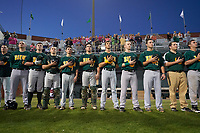 Siena Saints players, including Joe Drpich (47), Phil Madonna (3), Tyler Matis (1), Patrick Ortland (27), Alex Tuccio (20), and Jordan Folgers (12), stand for the national anthem before a game against the Stetson Hatters on February 23, 2016 at Melching Field at Conrad Park in DeLand, Florida.  Stetson defeated Siena 5-3.  (Mike Janes/Four Seam Images)