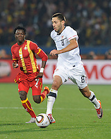 Clint Dempsey of the USA and Samuel Inkoom of Ghana. Ghana defeated the USA 2-1 in overtime in the 2010 FIFA World Cup at Royal Bafokeng Stadium in Rustenburg, South Africa on June 26, 2010.