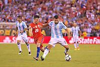 Action photo duringthe match Argentina vs Chile corresponding to the Final of America Cup Centenary 2016, at MetLife Stadium.<br /> <br /> Foto durante al partido Argentina vs Chile cprresponidente a la Final de la Copa America Centenario USA 2016 en el Estadio MetLife , en la foto:(i-d) Sergio Aguero de Argentina y Edson Puch de Chile<br /> <br /> 26/06/2016/MEXSPORT/ISAAC ORTIZ
