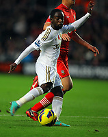 Saturday 10 November 2012<br /> Pictured L-R: Nathan Dyer of Swansea against Maya Yoshida of Southampton scoring the equalising goal for his team<br /> Re: Barclay's Premier League, Southampton FC v Swansea City FC at St Mary's Stadium, Southampton, UK.