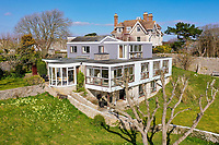 BNPS.co.uk (01202) 558833. <br /> Pic: Albury&Hall/BNPS<br /> <br /> A unique 'grand design' cliff-top home that has dramatic sea views has gone on the market for £2m.<br /> <br /> The three storey six-bedroom property was designed in the 1960s by architect John Morgan for him to live in.<br /> <br /> At the time the flat-roofed building with floor to ceiling windows was considered a revolutionary design.<br /> <br /> The property's stunning location on the cliffs above Swanage in Dorset provide uninterrupted sea views of Poole Bay and across to The Needles on the Isle of Wight.
