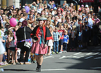 Pictured: Saturday 17 September 2016<br /> Re: Roald Dahl's City of the Unexpected has transformed Cardiff City Centre into a landmark celebration of Wales' foremost storyteller, Roald Dahl, in the year which celebrates his centenary.<br /> A town crier gets the crowd going on Westgate Street.