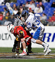 Sam Payton (32) of Duke fights for the face-off with Bryn Holmes (17) of Maryland during the Face-Off Classic in at M&T Stadium in Baltimore, MD