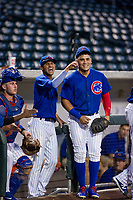 Luis Vazquez (1) and Luis Hidalgo (18) of the AZL Cubs joke with their opponent before a game against the AZL Giants on September 6, 2017 at Sloan Park in Mesa, Arizona. AZL Giants defeated the AZL Cubs 6-5 to even up the Arizona League Championship Series at one game a piece. (Zachary Lucy/Four Seam Images)
