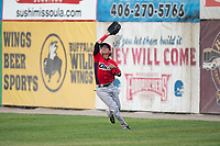Orem Owlz right fielder Rayneldy Rosario (12) prepares to catch a fly ball during a Pioneer League game against the Missoula Osprey at Ogren Park Allegiance Field on August 19, 2018 in Missoula, Montana. The Missoula Osprey defeated the Orem Owlz by a score of 8-0. (Zachary Lucy/Four Seam Images)