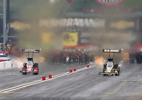 Aug 30, 2014; Clermont, IN, USA; NHRA top fuel dragster driver Tony Schumacher (right) races alongside Spencer Massey in the Traxxas Shootout during qualifying for the US Nationals at Lucas Oil Raceway. Mandatory Credit: Mark J. Rebilas-USA TODAY Sports