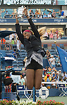 Serena Williams (USA) celebrates with the trophy after her 6-3, 6-3 victory over Caroline Wozniacki (DEN) at the US Open being played at USTA Billie Jean King National Tennis Center in Flushing, NY on September 7, 2014