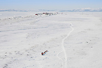 Aerial of Paul Gehardt at the Lagoon nearing the Shaktoolik checkpoint in Arctic Alaska during the 2010 Iditarod