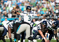 CHARLOTTE, NC - DECEMBER 15: Russell Wilson #3 of the Seattle Seahawks calls signals during a game between Seattle Seahawks and Carolina Panthers at Bank of America Stadium on December 15, 2019 in Charlotte, North Carolina.