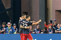 FOXBOROUGH, MA - JULY 25: Gustavo Bou #7 of New England Revolution celebrates his goal with teammate during a game between CF Montreal and New England Revolution at Gillette Stadium on July 25, 2021 in Foxborough, Massachusetts.