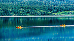Kayakers on Lake Quinault, at Willaby Creek Campground.  Olympic National Forest, Olympic National Park, Washington, USA.