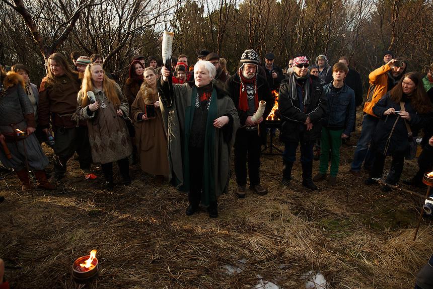 Jóhanna Harðardóttir brings offering to the deities at the hight of the solar eclipse in Reykjavik Iceland.