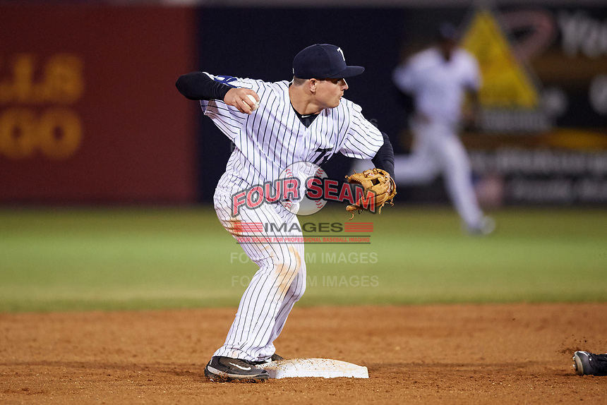 Tampa Yankees second baseman Nick Solak (39) throws to first base as Jose Azocar (out of frame) slides in during a game against the Lakeland Flying Tigers on April 7, 2017 at George M. Steinbrenner Field in Tampa, Florida.  Lakeland defeated Tampa 5-0.  (Mike Janes/Four Seam Images)