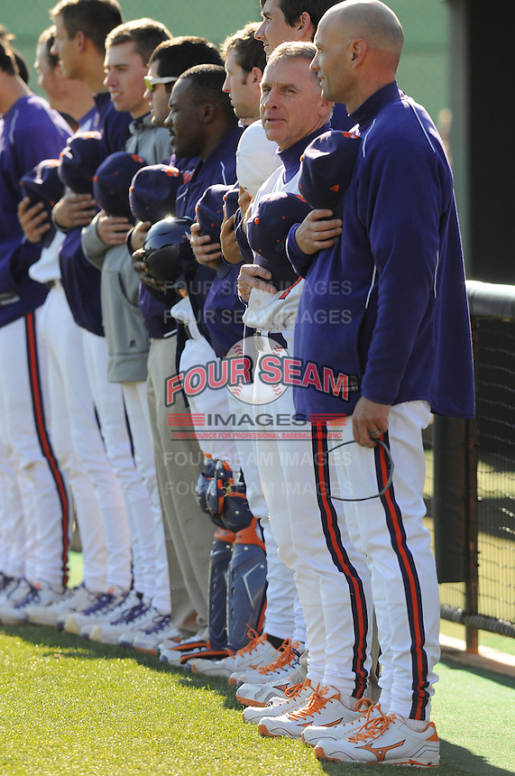 Members of the Clemson Tigers stand for the National Anthem prior to a game against the the Wofford Terriers on Wednesday, March 6, 2013, at Doug Kingsmore Stadium in Clemson, South Carolina. Clemson won, 9-2. (Tom Priddy/Four Seam Images)