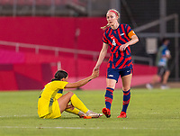 KASHIMA, JAPAN - AUGUST 5: Sam Kerr #2 of Australia shakes hands with Becky Sauerbrunn #4 of the USWNT after a game between Australia and USWNT at Kashima Soccer Stadium on August 5, 2021 in Kashima, Japan.