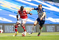 20th June 2020, American Express Stadium, Brighton, Sussex, England; Premier League football, Brighton versus Arsenal ;  Arsenals Nicolas Pepe makes room against Brighton and Hove Albions Dan Burn before scoring his goal in the 68th minute for 0-1