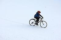 Josh riding bike  in the snow..Virginia Water , Surrey  December 2009..