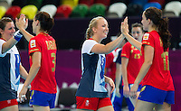 25 JUL 2012 - LONDON, GBR - Nina Heglund (GBR) of Great Britain (third from the left) congratulates Elisabeth Pinedo Saenz (ESP) of Spain after the two teams women's London 2012 Olympic Games warm up handball match in The Copper Box in the Olympic Park, in Stratford, London, Great Britain which was won by Spain .(PHOTO (C) 2012 NIGEL FARROW)