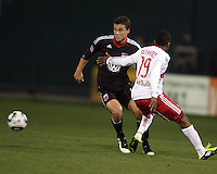 Mark Burch (4) of D.C. United moves past Dane Richards (19) of the New York Red Bulls during an MLS match at RFK Stadium, in Washington D.C. on April 21 2011. Red Bulls won 4-0.