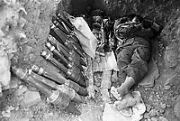Karenni guerrilla sleeping in a bunker beside a Burma Army machine gun and Chinese-made rocket propelled grenades.