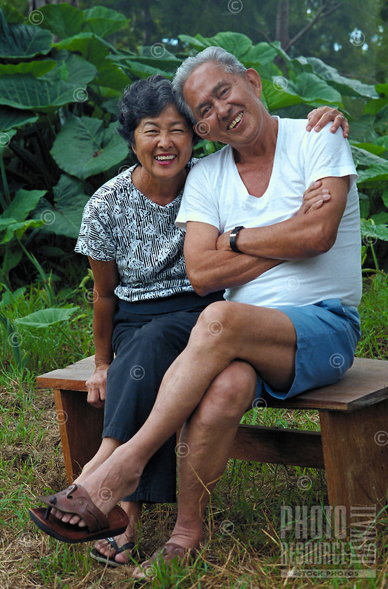 Senior couple, Japanese Korean husband and wife in outdoor setting