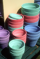 Colorful empty clay pots, stacked and clean, ready for garden use, green and blue and purple and red terracotta container plant