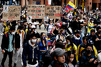 BOGOTA, COLOMBIA - MAY 01 : Demonstrators participate in a protest against the Duque package and the tax reform during the International Workers' Day on May 01, 2021 in Bogota, Colombia. Hundreds of Colombians protest against a tax bill reform plan for the fourth day in a row which aimed to raise some $ 6.3 billion in additional revenue over 10 years for Colombia, which saw GDP fall 6.8 percent in 2020 .(Photo by Leonardo Munoz/VIEWpress)