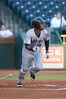 Manuel Geraldo (26) of the Augusta GreenJackets starts down the first base line against the Greensboro Grasshoppers at First National Bank Field on April 10, 2018 in Greensboro, North Carolina.  The GreenJackets defeated the Grasshoppers 5-0.  (Brian Westerholt/Four Seam Images)