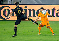 CARSON, CA - OCTOBER 28: Diego Rossi #9  of the Los Angeles FC battles with Jose Bizama #18 of the Houston Dynamo during a game between Houston Dynamo and Los Angeles FC at Banc of California Stadium on October 28, 2020 in Carson, California.