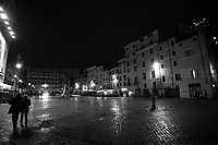 """This Story is dedicated to: Catia, Angelo, Gabriele e Laity.<br /> <br /> Campo de' Fiori.<br /> <br /> Rome, 23/10/2020. Documenting the """"curfew"""" (coprifuoco) imposed from Friday night in Rome and its surrounding Lazio Region. The local authorities tightened rules and restrictions due to a spike in the Covid-19 / Coronavirus cases. 23 October bulletins sees 19.143 new cases, 91 people died, 182.032 tests made. Today, the President of Lazio Region, Nicola Zingaretti (Leader of the Democratic Party, PD, party member of the Italian Coalition Government), imposed the night curfew, from midnight to 5AM, for 30 days (1.). A new self-certification (autocertificazione, downloadable from here 1.) is needed to leave home which is allowed only for urgent reasons, mainly work and health. Furthermore, the Mayor of Rome, Virginia Raggi, implemented """"no-go zones"""" restrictions from 9PM in some of the areas and squares of the Eternal City famous for the nightlife, including Campo de' Fiori, Via del Pigneto, Piazza Trilussa in Trastevere district and Piazza Madonna de' Monti.<br /> <br /> Footnotes & Links:<br /> 1. http://www.regione.lazio.it/binary/rl_main/tbl_news/ordinanza_regione_lazio_intesa_Ministro_salute__mod_accettate_rev1__ore_24_1_signed.pdf<br /> <br /> March 2020, Coronavirus lockdown in Rome:<br /> - 12.03.2020 - Rome's Lockdown for the Outbreak of the Coronavirus In Italy - SARS-CoV-2 - COVID-19: https://lucaneve.photoshelter.com/gallery/12-03-2020-Romes-Lockdown-for-the-Outbreak-of-the-Coronavirus-In-Italy-SARS-CoV-2-COVID-19/G0000jGtenBegsts/<br /> - 07-23.03.2020 - Villaggio Olimpico Ai Tempi del COVID-19 - Rome's Olympic Village Under Lockdown: https://lucaneve.photoshelter.com/gallery/07-23-03-2020-Villaggio-Olimpico-Ai-Tempi-del-COVID-19-Romes-Olympic-Village-Under-Lockdown/G0000D2L9l0ibXZI/"""