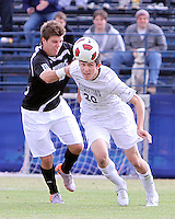 Andy Riemer #20 of Georgetown University nods the ball past John Raley #6 of Providence University during a Big East quarter-final  match at North Kehoe Field, Georgetown University on November 6 2010 in Washington D.C. Providence won 2-1.