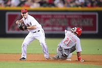 May 13, 2009; Phoenix, AZ, USA; Arizona Diamondbacks shortstop Stephen Drew throws to first base after forcing out Cincinnati Reds base runner Chris Dickerson at Chase Field. Mandatory Credit: Mark J. Rebilas-