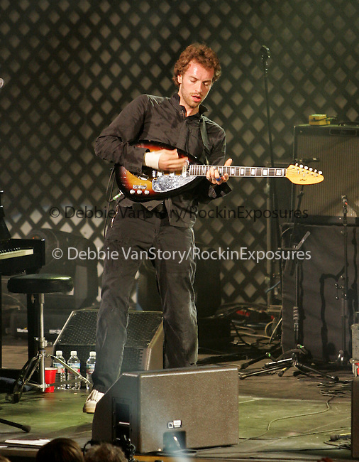 Chris Martin of Coldplay performs live at the 106.7 KROQ Almost Acoustic Christmas 2005 night two held at The Gibson Ampitheatre in Universal City,California on December 11,2005.(Pictured:Chris Martin,Coldplay).Copyright 2005 by RockinExposures
