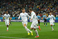 Wayne Rooney of England celebrates scoring a goal with Ross Barkley after making it 1-1