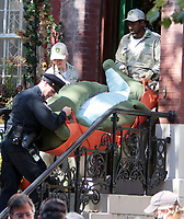 September 24, 2021. Extra dress as NYC Wildlife officers filming on location for  Sony pictures Lyle Lyle Crocodile<br />   with a stuff crocodile as special effects shot for post in New York September 24, 2021 Credit:RW/MediaPunch