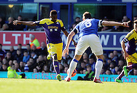Pictured L-R: Roland Lamah of Swansea prepares to take a shot and Phil Jakielka of Everton. Sunday 16 February 2014<br /> Re: FA Cup, Everton v Swansea City FC at Goodison Park, Liverpool, UK.